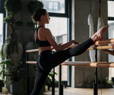 woman-in-black-sports-bra-and-black-leggings-doing-yoga-4324017